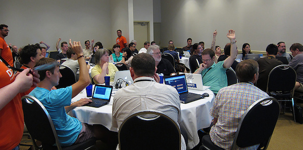 sprint workshop participants raising hands